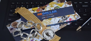 jewelry and silver coin on redollar envelope