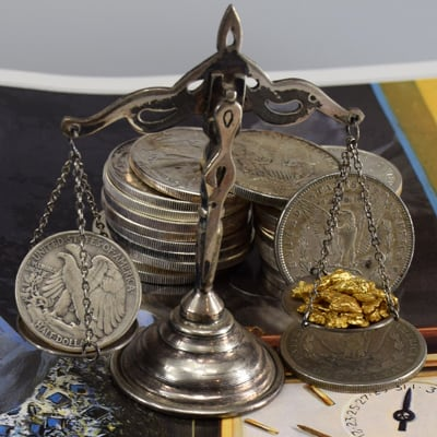 12.52 pennyweight of pure gold on scale compared with US silver coins