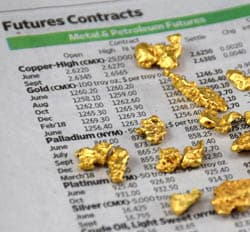 Nuggets on newspaper with current gold price